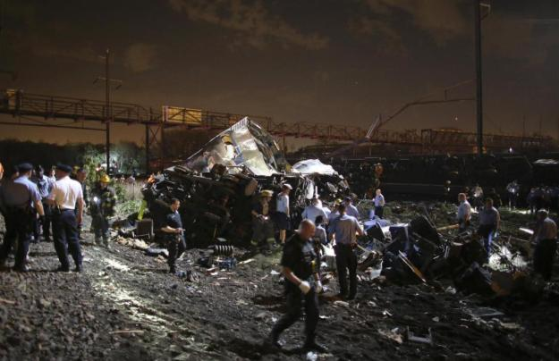 Emergency personnel work the scene of a train wreck, Tuesday, May 12, 2015, in Philadelphia. An Amtrak train headed to New York City derailed and crashed in Philadelphia. (AP Photo/Joseph Kaczmarek)