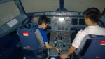 I sat on the captain's seat which is on the left while the pilot sat on the co-pilot seat.