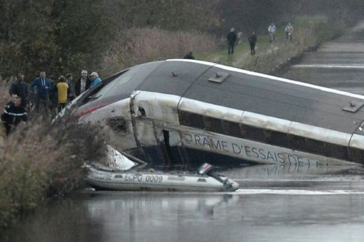 Rescuers work at the scene where a high-speed TGV train coach and engine carriage lie in a canal in Eckwersheim near Strasbourg, northeastern France, after derailing on November 14, 2015.