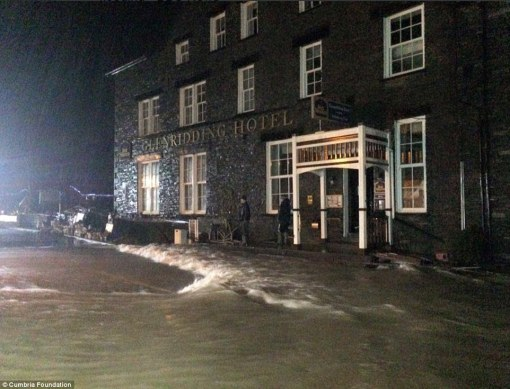 As homeowners were beginning the huge clean-up operation to salvage as many of their possessions hit by the first wave of flooding as possible, the River Beck burst its banks again last night and sent raging torrents through the small village of Glenridding, Cumbria. (Photo by DailyMail)
