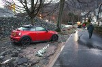 Flood: When the river burst its banks it sent raging torrents filled with trees, rocks and other debris (pictured) racing through the village Cumbria flood misery as Glenridding river bursts banks again. (Photo by DailyMail)