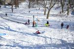 Children enjoy some fun in the snow in Central Park in New York City, Jan. 24, 2016. Over 25 inches of snow in Central Park marked the third-largest snowfall since record-keeping began in 1869, police and weather officials said. (Gordon Donovan/Yahoo News)