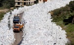 The overflowing piles of rubbish are threatening the water supply and people continue to burn garbage, despite a government ban, filling the air with foul smoke that contains dangerous levels of pollutants and carcinogens.