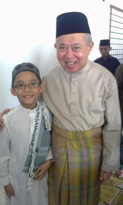 A photo of Ku Li and I, after our Friday prayer in December 2013.