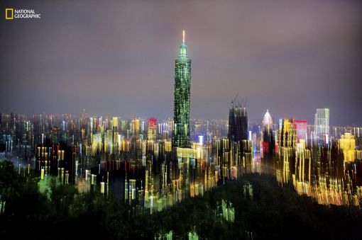 The city lights of Taipei burn in multicolour after dark. (Dina Litovsky/National Geographic)