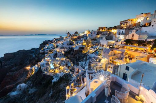 The town of Oia in Santorini clings to the hillside under an inky blue sky. (Matt Parry)