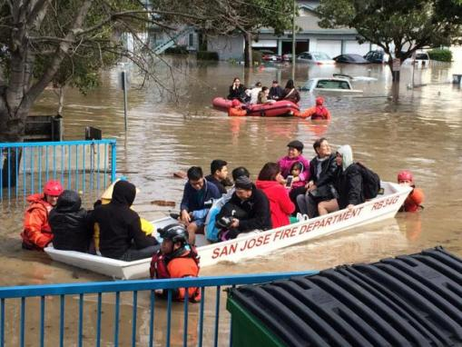 Rescuers from the San Jose Fire Department pilot boats while evacuating residents of Nordale Avenue after the Coyote Creek flooded parts of San Jose, California, U.S. February 21, 2017.  Courtesy of Chris Smead/Csmeadphotography/Handout via REUTERS