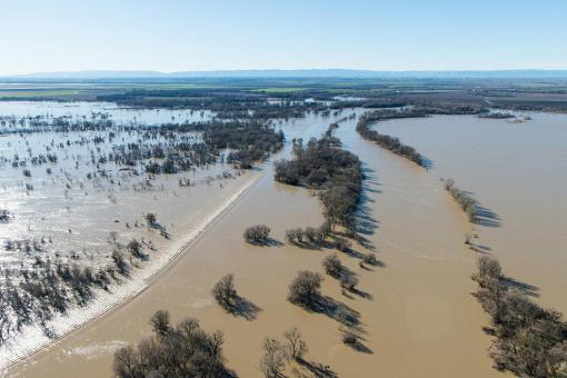 Due to recent storms, Fremont Weir in Knights Landing, Calif. is overtopping, January 13, 2017. The Fremont Weir Wildlife Area is 1,461 acres at the north end of the Yolo Bypass floodway along the Sacramento River in Sutter and Yolo counties. (Photo credit to Florence Low / California Department of Water Resource)