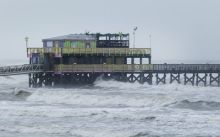 The Galveson Fishing Pier stands ahead of Hurricane Harvey in Galveston, Texas Credit: F Carter Smith/Bloomberg