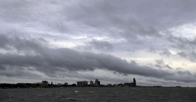 Clouds and rain form over downtown Corpus Christi, Texas, as the outer bands of Hurricane Harvey move closer to shore, Friday, Aug. 25, 2017. (Photo: Eric Gay/AP)