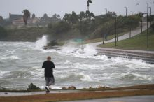 Sal Valerio walks near the bay waters as they churn from approaching Hurricane Harvey on August 25, 2017 in Corpus Christi, Texas. (Photo: Joe Raedle/Getty Images)