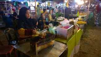 The satay ikan stall. Satay ikan is keropok lekor balls on sticks grilled over charcoal fire. Pasar Malam Dungun, Oct. 24, 2017.