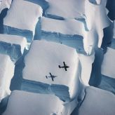 The photo, taken in early 1995 during a flight over the English Coast (southern Antarctic Peninsula) at about 74 degrees south, illustrates the scale of unusual bi-directional crevassing as an ice sheet is stretched in two directions over an underlying rise, with a Twin Otter aeroplane as scale. It was named as Overall winner and winner in the Earth Science and Climatology category. (PA)