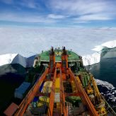 The Russian research vessel Akademik Tryoshnikov leans the bow against the Mertz Glacier's snout in Eastern Antarctica. The photo was taken moments before deploying ROPOS, a Remotely Operated Underwater Vehicle (ROV) under the glacier tongue to investigate the melting of the ice-sheet after a piece of ice protruding 100 kilometres (62 miles) out into the Southern Ocean broke away from the main body of the tongue in 2010. It was named as runner up in the Earth Science and Climatology category. (PA)
