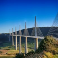 Running through the valley of the River Tarn near Millau in southern France, the Millau Viaduct is the world's tallest bridge, with a summit that rises some 1,125 feet above the base of the structure. Designed by architect Sir Norman Foster and structural engineer Michel Virlogeux, the bridge opened in 2004.