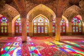 Also known as the Pink Mosque, the Nasir Al-Mulk Mosque features a sprawling presentation of candy-color glass mosaic ceilings, accentuated by kaleidoscopic stained-glass windows and rainbow-hued carpets.