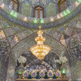 Shah Cheragh, a funerary monument and mosque, is also known as the Emerald Mosque because of its mesmerizing mirror-mosaic ceiling and the shimmering chandeliers that hang from it.
