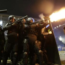 Riot police fire tear gas at demonstrators in Jakarta[Dita Alangkara/AP Photo]
