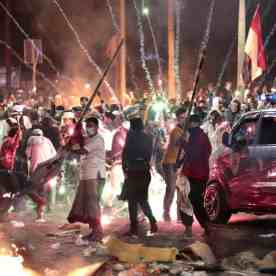 Fire crackers explode near supporters of presidential candidate Prabowo Subianto during clashes with the police in Jakarta on Wednesday. Photograph: Dita Alangkara/AP