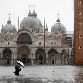 A person photographs a flooded St. Mark's Square on November 12.Luca Bruno/AP