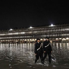 Police officers patrol a flooded St. Mark's Square during the high tide on November 12.Marco Bertorello/AFP via Getty Images